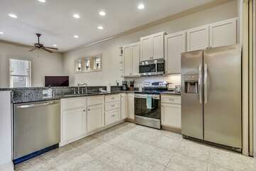 Main level - spacious kitchen with granite countertop and stainless appliances