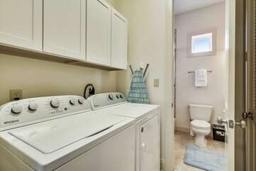 Laundry room with storage and full size washer and dryer