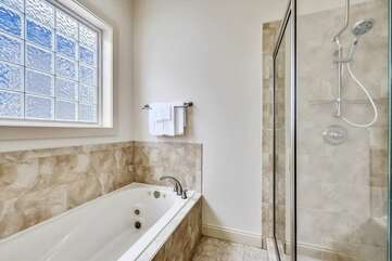 Upper level - master bathroom with large soaking tub and tile shower