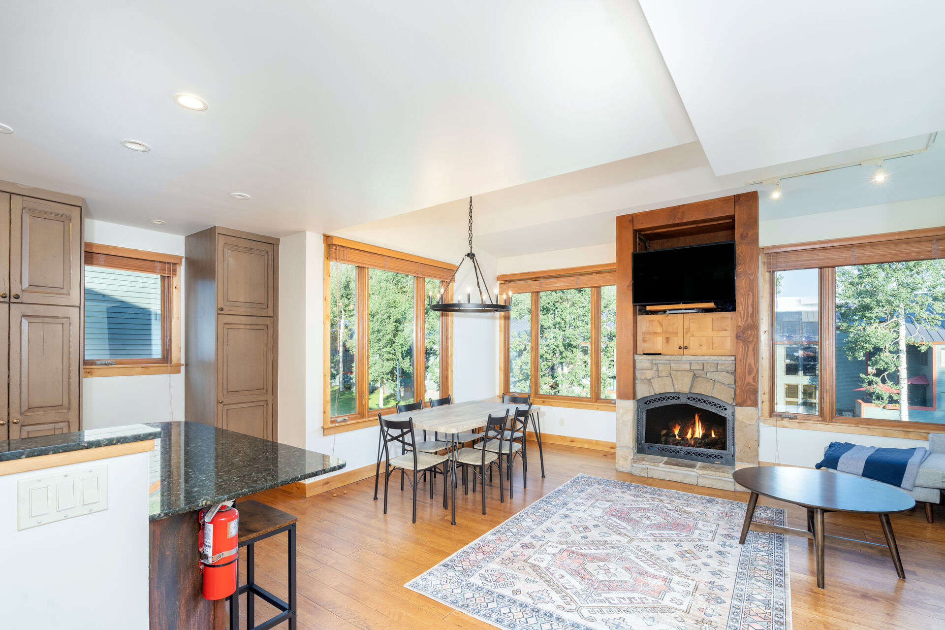 Open floor plan dining and living room with wood floors