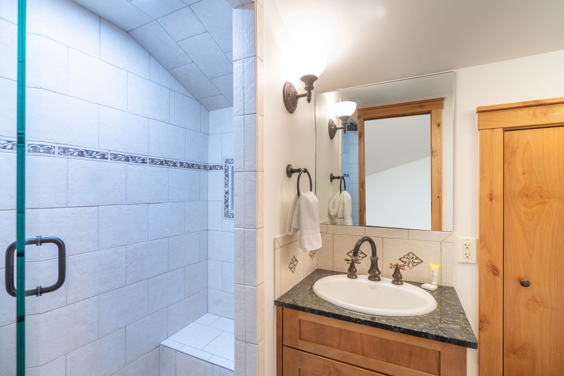 bathroom with white tile sit-in shower