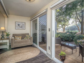 The great room opens to the sunroom with a Twin pull-out.