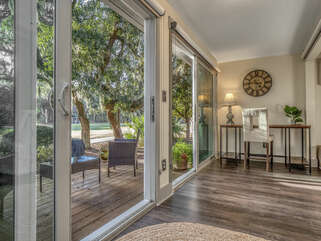 The sunroom has large sliders facing the 8th hole of Ocean Winds Golf Course.