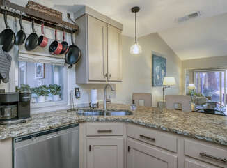 The kitchen has granite counter tops and stainless steel appliances.