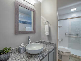 The master bath has granite counters and a tub/shower combo.