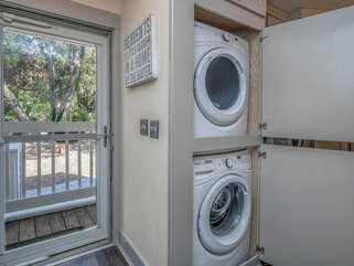 Off the kitchen, just inside the front door is the laundry closet with a stackable washer and dryer.