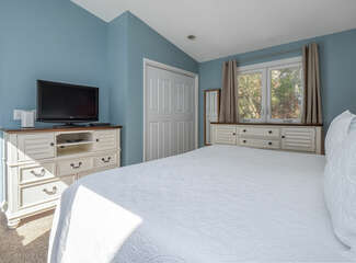 There is a large closet and plenty of light streaming in. Windows showcase the golf course.