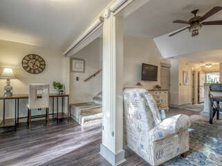 Shades pull down to provide privacy to the great room.  The sunroom has a desk area.  A perfect spot for the