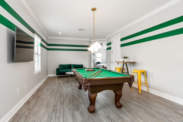 Play a friendly game of Billiards in the upstairs loft