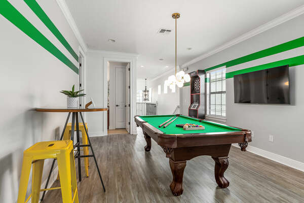 Guests can sit at the high top table and have a bite to eat while they wait for their turn on the Billiards table