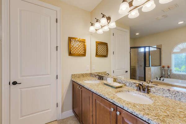 En-suite bathroom with dual sinks