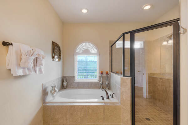 Garden tub and walk-in glass shower