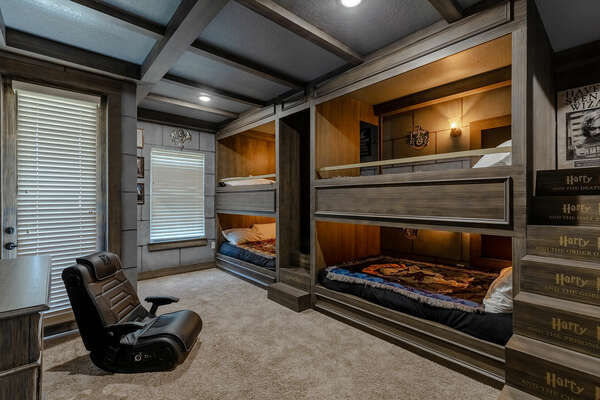 Transport your kids to a world of wizardry and magic with two full-sized bunk beds