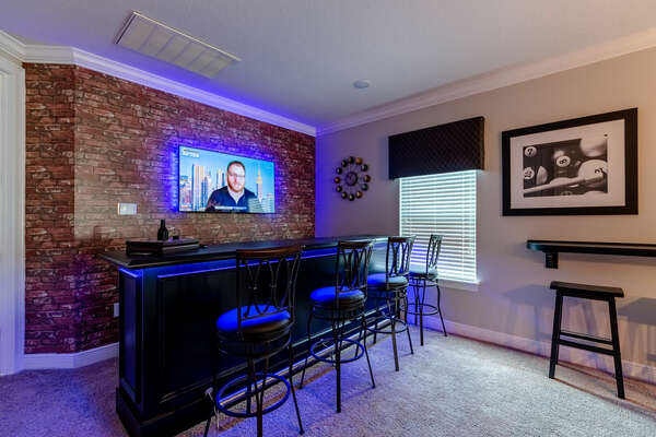 Sit at the bar and watch your favorite team on the SMART TV in the lounge