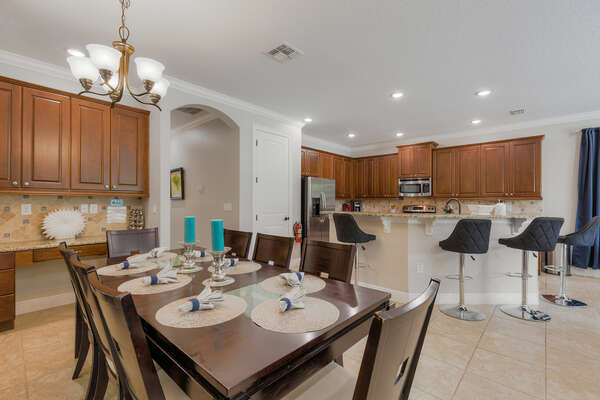 Indulge in a delicious meal at the breakfast bar with seating for four