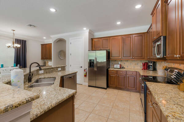 The kitchen is supplied with multiple appliances perfect for any chef