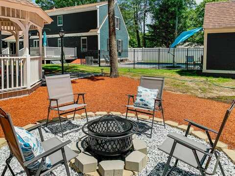 Family fire pit area in this beautiful back yard with gazebo and pool - 44 Avalon Circle Osterville Cape Cod New England Vacation Rentals