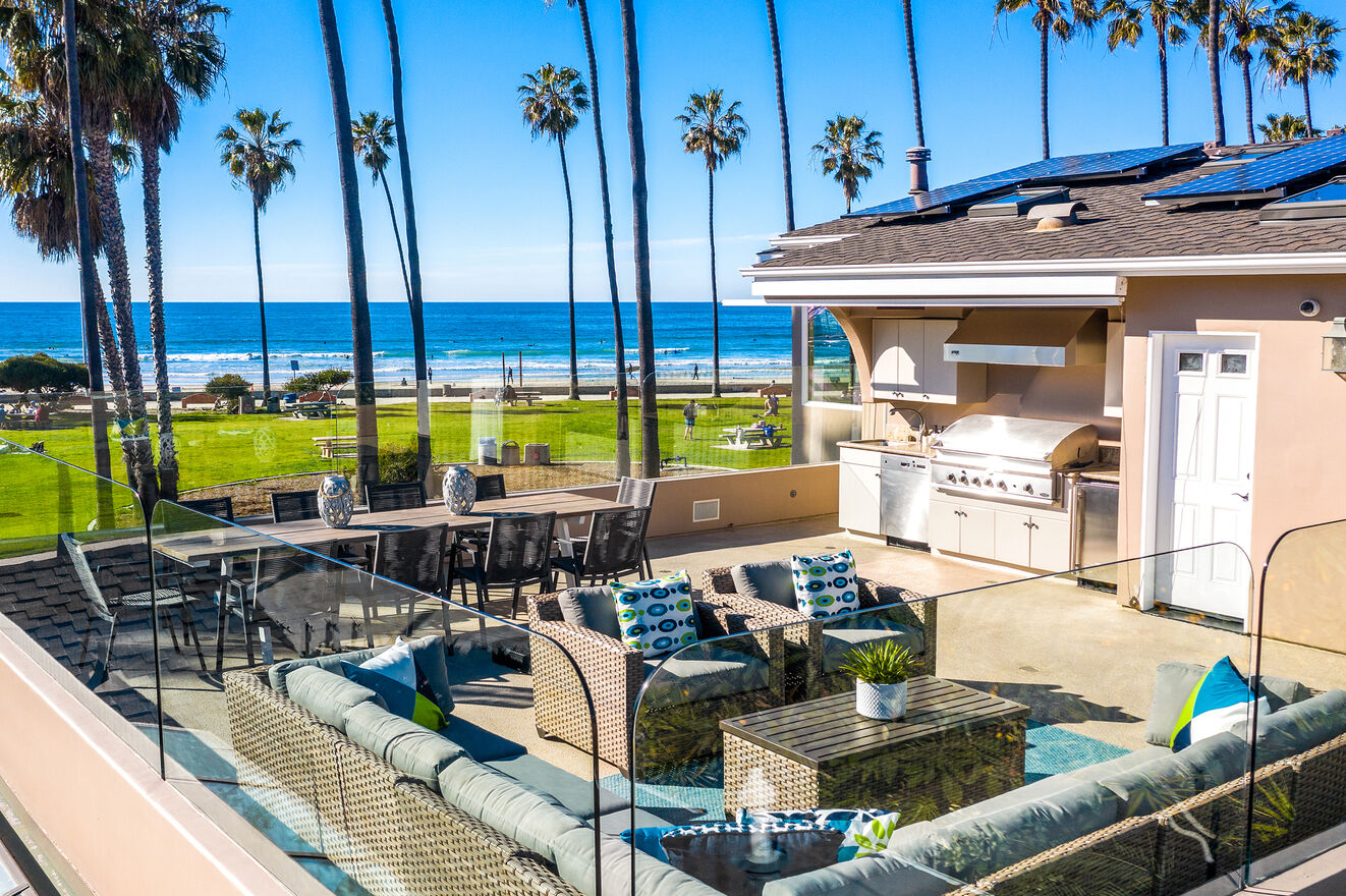 Rooftop Deck oceanfront with sitting area, dining area, and kitchen