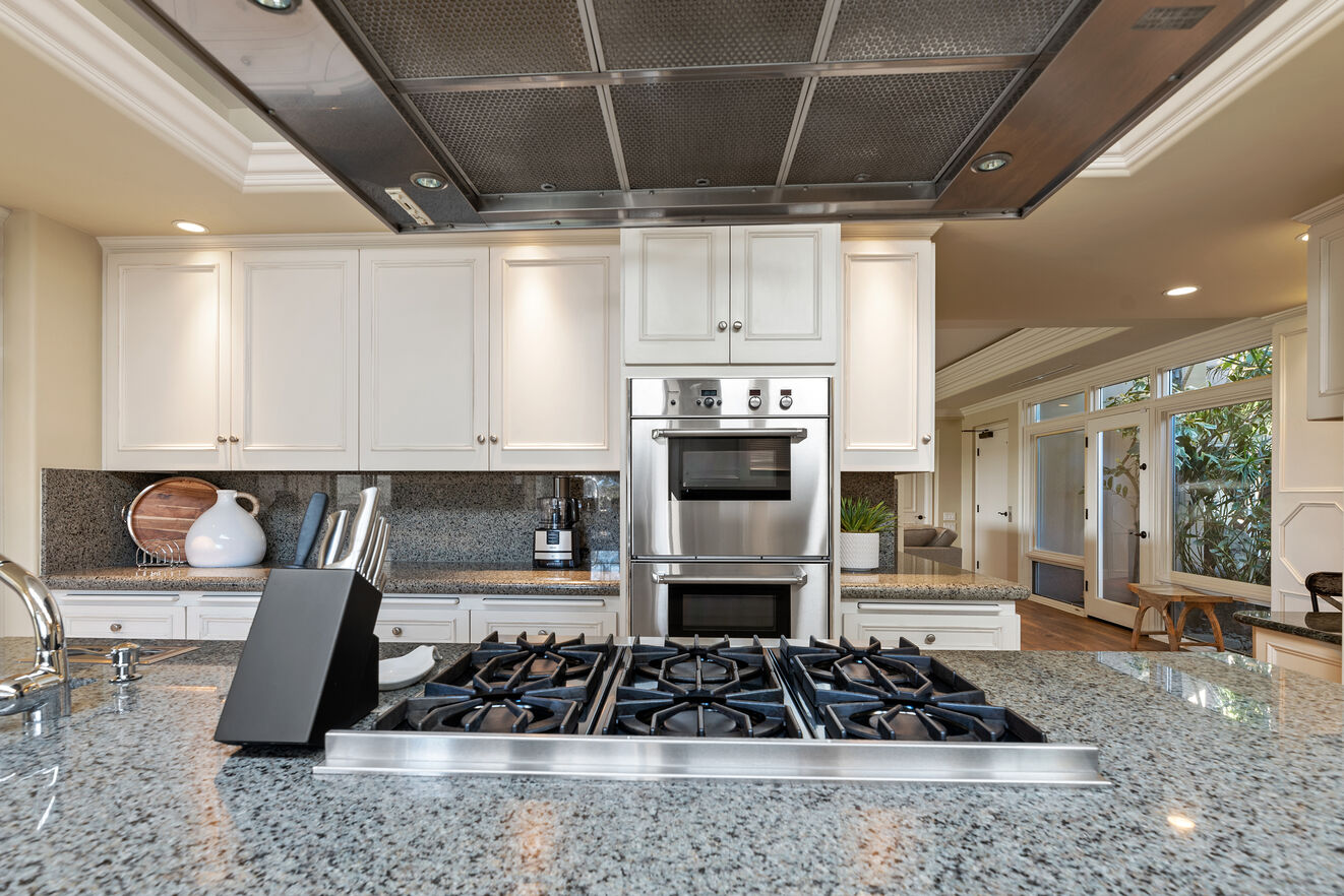 The large island range allows for the chef in your group to whip up a gourmet meal.