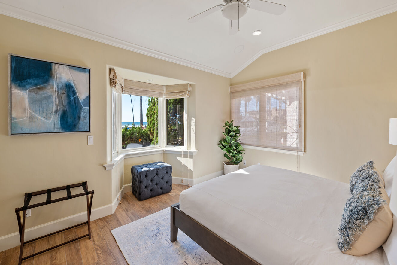 Bedroom # 1 - main level with oceanfront view, King size bed, shared bathroom