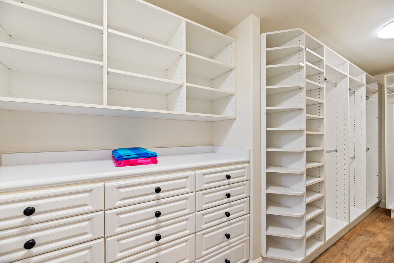Large his and hers walkthrough master closet for bedroom # 5