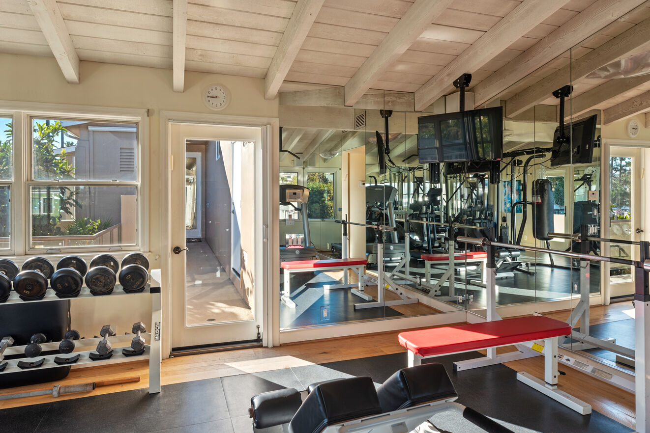 Full gym accessible through outdoor walkway or secret master closet entrance.
