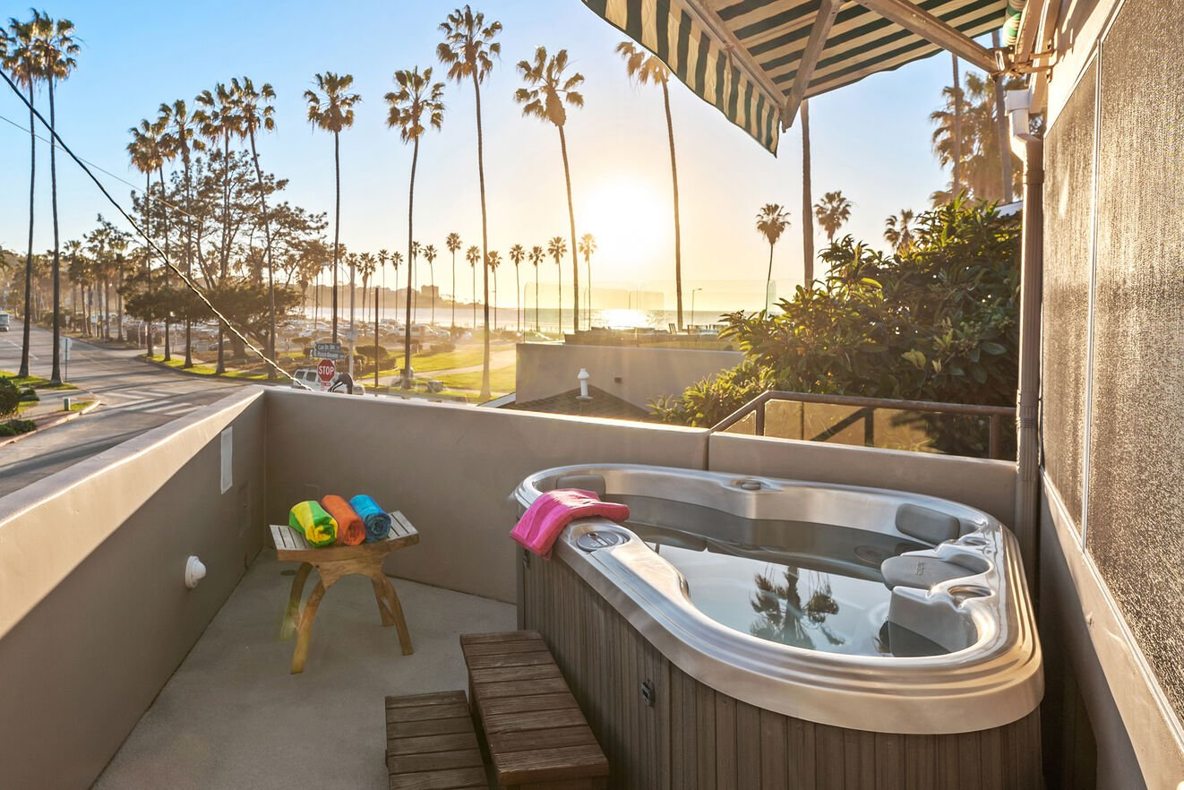 Hot tub with ocean view accessible through the gym.