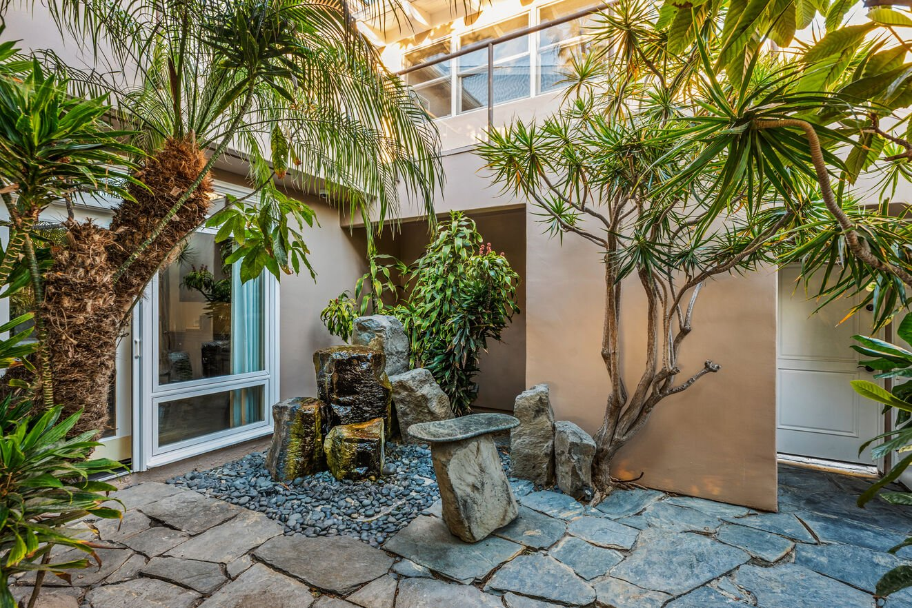 Atrium located in the center of the home with garage access.