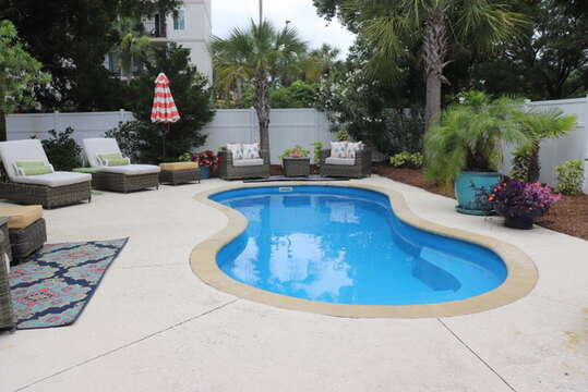 Pool area with tropical landscaping