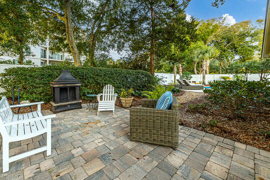 Side yard sitting area with outdoor fireplace