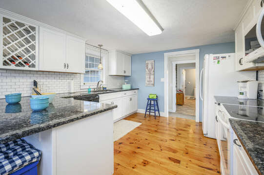 Kitchen with quaint details like wide pine floors and wine rack - 85 Pond Street South Yarmouth Cape Cod - New England Vacation Rentals
