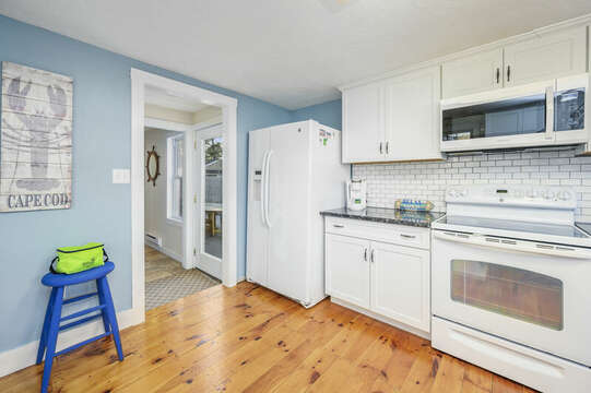 New white appliances and subway tiles add to the bright look of this family kitchen - 85 Pond Street South Yarmouth Cape Cod - New England Vacation Rentals