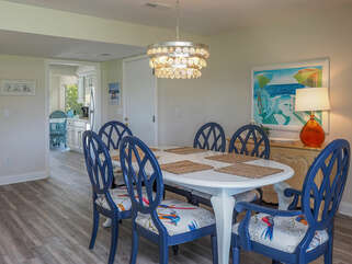 The dining area sits between the great room and the kitchen. A large table with seating for 6