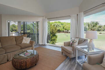 Beautiful floor to ceiling windows give you panoramic views of Crooked Oaks golf course.  A slider leads out to your balcony