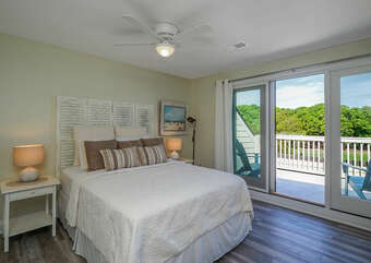The second floor has a queen guest bedroom with sliders leading out to a private deck.
