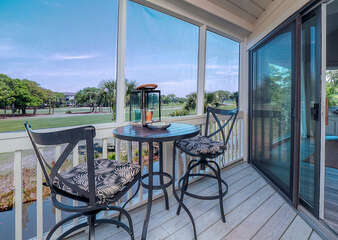 The screen porch is the perfect spot for a morning cup of coffee or afternoon cocktail. The porch is located off the great room/dining room area
