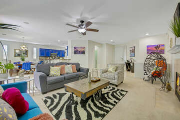 This vacation home opens up to a spacious living room with a gourmet kitchen and a casual dinning area.