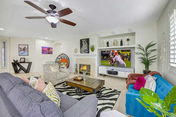 There is plenty of room in the living room to lounge in front of a 70-inch Vizio Smart television, Apple TV, and natural gas Fireplace.