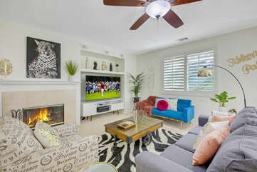 Stay cool under the switch-controlled ceiling fan and comfortable sofa which includes a Queen-sized Sofa Sleeper.