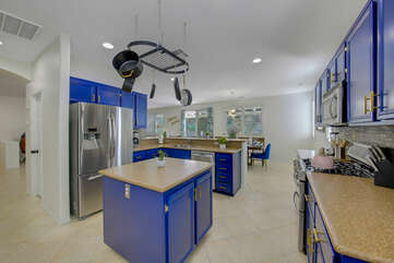 The fully-equipped kitchen features stunning stainless steel appliances such as a GE french door refrigerator with a water and ice dispenser.