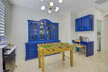 The kitchen features a foosball table for some fun while chatting it up with the cook.