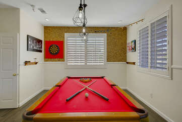 The Game Room is located at the end of the hallway next to Bedroom 4 which features a full-size pool table and dartboard.
