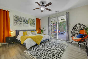 Master Suite 1 is located next to the front door and features a King-sized Bed, 50-inch HiSense with Roku Smart television and  access to the back patio.