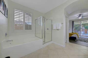 Private, en suite bathroom features a soaking tub, tile shower.