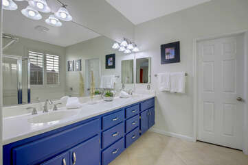 The private en suite bathroom has two vanity sinks, perfect space to get ready for night out, or in!