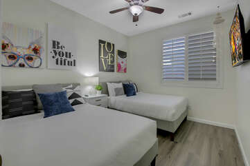 Bedroom 4 features two Full-sized Bed and a 50-inch TCL with Roku Smart television.
