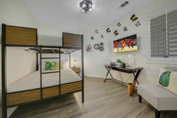 Bedroom 2 is located next to the hallway bathroom and features a Full Over Full Bunk Bed.