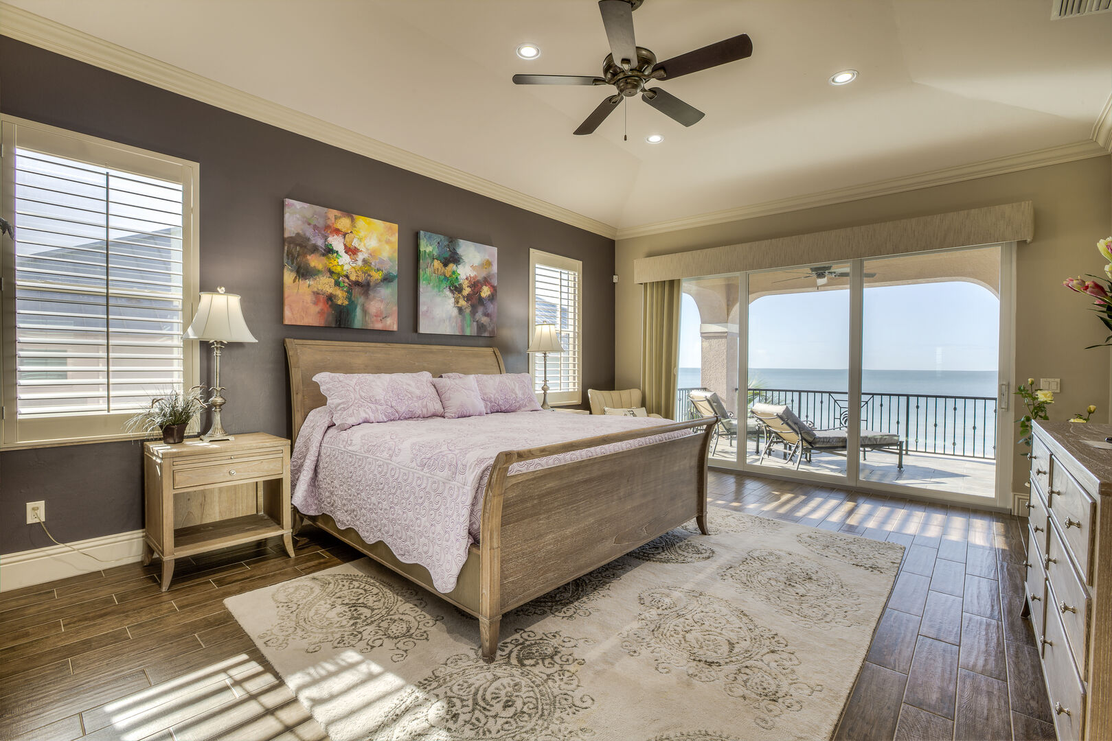 Master bedroom with king bed and balcony in our Fort Myers vacation home rental