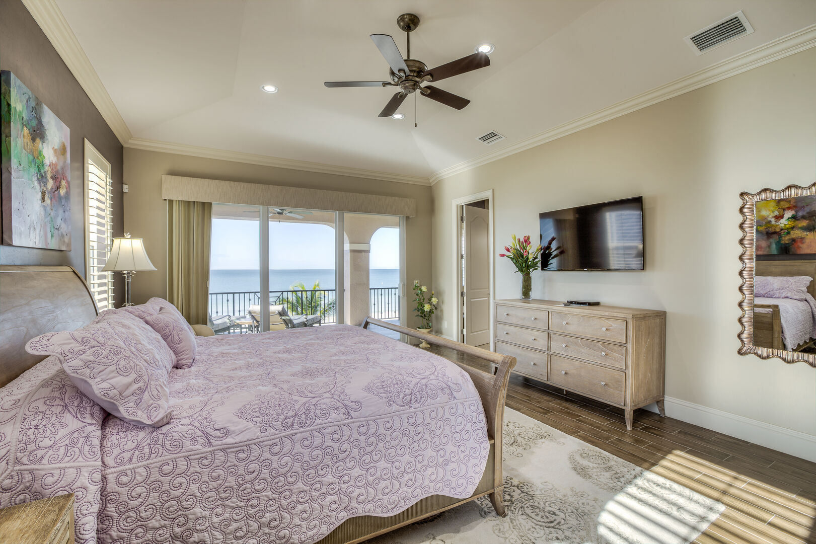 Master bedroom with king bed and TV in our Fort Myers vacation home rental