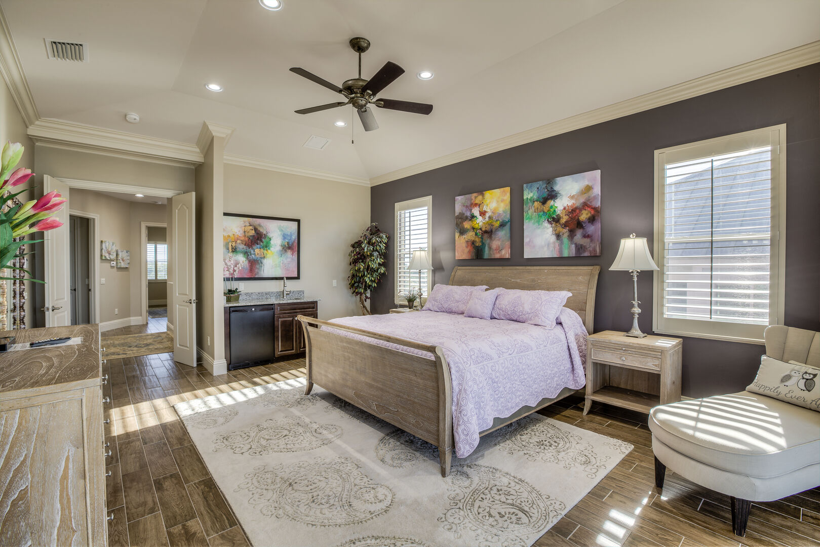 Master bedroom with king bed and chaise in our Fort Myers vacation home rental
